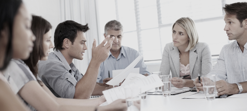 Business man discussing a point during meeting